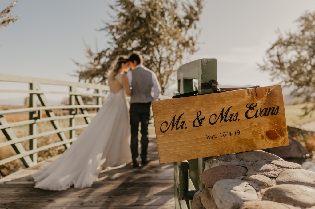 Couple Standing On Bridge After Affordable Wedding Near Lake Tahoe